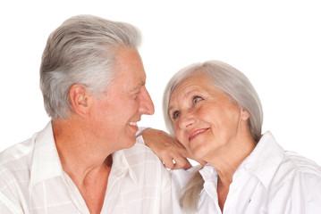 elderly couple  on a white