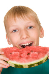 handsome boy eating watermelon