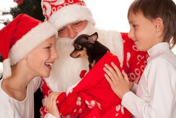 Santa gives presents to children