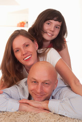 family of three on a light
