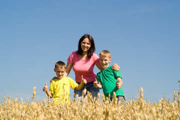 happy mother with two boys