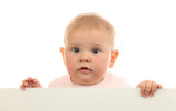 Cute baby girl holding empty white board