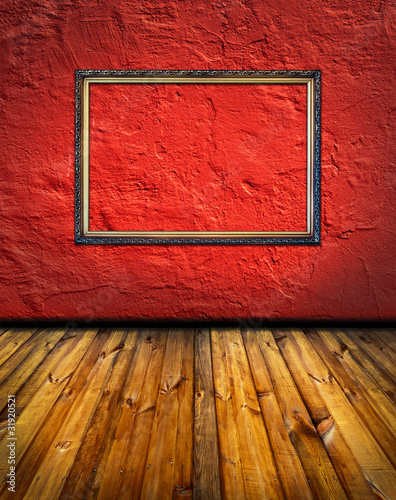 vintage red terracotta interior with empty classic frame hanging