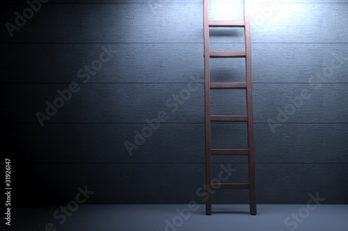 Wooden ladder on concrete background