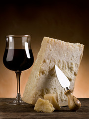 parmesan cheese and glass of red wine