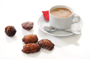 traditional spanish fritters and a white coffee