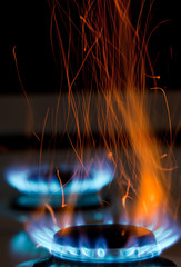 flames over gas stove