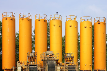 yellow silos in industrial site