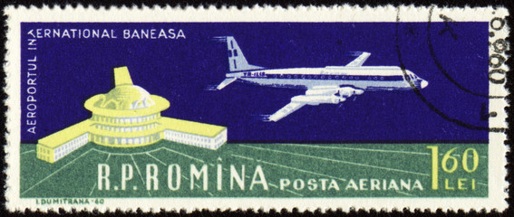Airport of Bucharest and large plane on post stamp