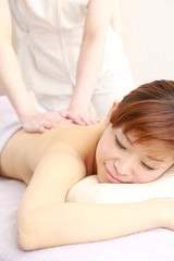 young japanese woman getting a massage