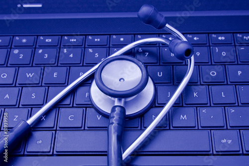 Stethoscope on laptop's keyboard