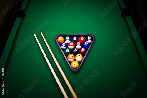 Billiard balls over table