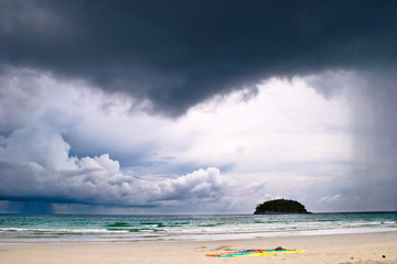 Beautiful tropical beach under gloomy sky.