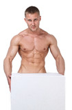 Strong wet sexy nude young bodybuilder hold in hands the cube fo