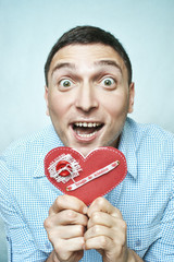 Crazy happy guy holding red valentine card