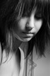 Beautiful young girl looking depressed in black and white