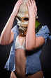 Girl in gasmask holding her head