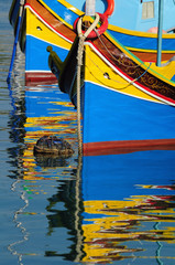 Traditional Maltese fishing boat with reflection