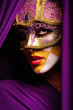 portrait of woman in violet mask