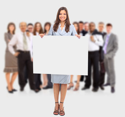 Isolate of a business woman standing beside a blank