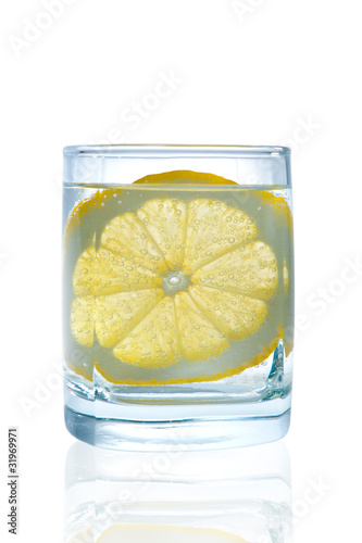 Full glass of water with lemon