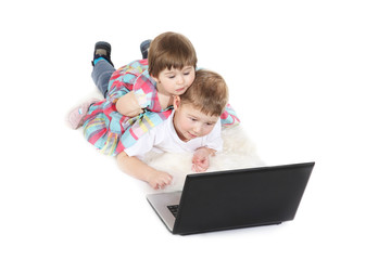brother and the sister look cartoon films on a laptop