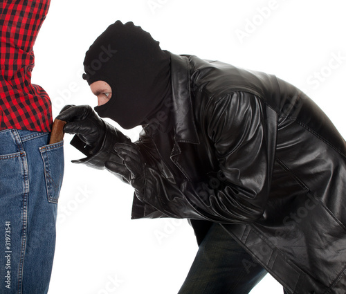 thief in black jacket and balaclava - pickpocket in action