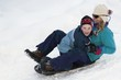 Mother And Son Sledding