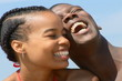 Young African American couple in red bikini with blue sky backgr