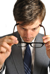 Man Putting on Eye Glasses