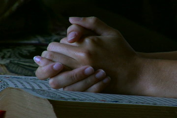 Woman praying with Bible
