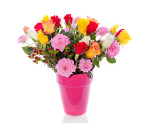 colorful mixed bouquet with roses and Dahlia in a pink vase isol