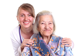 Nurse smiling with an elderly women