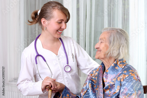 Senior woman being visited by a doctor