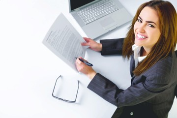 Business woman in an office with laptop