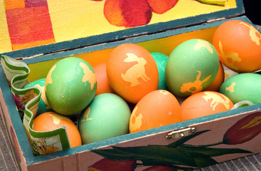 Many colorful ornamented eggs on decorated box