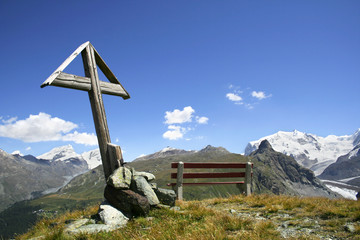 Cross on top of a mountain