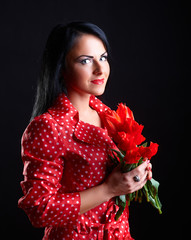 Young woman with red flowers