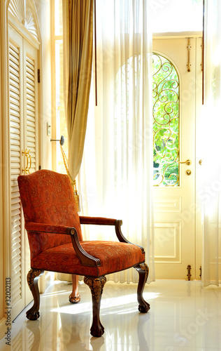 Classic chair in front of the window