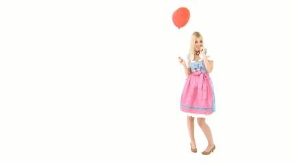Frau im Dirndl mit Ballon