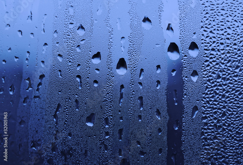 water drops on glass © Dinadesign