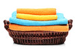 A studio shot of colorful towels in a basket