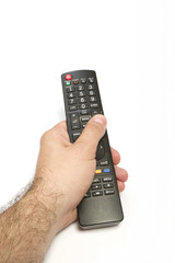 Male hand holding remote control