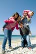 Happy family having fun by the sea