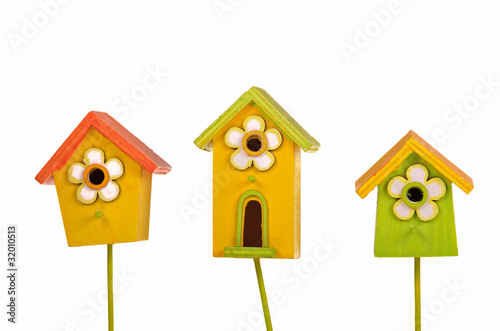 Three funny colorful starling-houses isolated on white