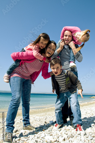 Happy family having fun by the sea