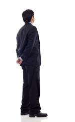 Asian Businessman from the back looking at something