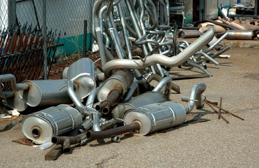 Pile of Mufflers, auto shop back yard