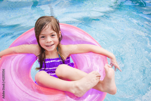 Cute little girl Happily playing in the swimming pool