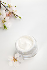 Face cream and almond flowers